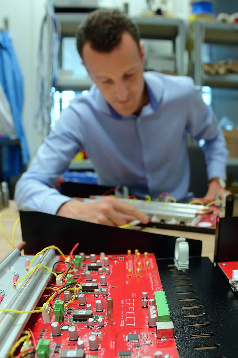 man testing a chip panel