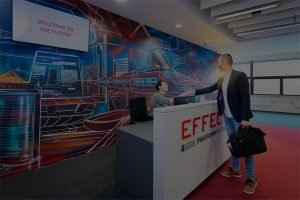 Customer being welcomed at effect photonics reception desk